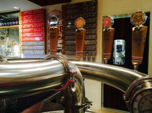 The bar at Whole Foods Market Brewing features a total of 20 beer taps, a handful of which are devoted to in-house beers, such as the Berry White, a Belgian White Ale.